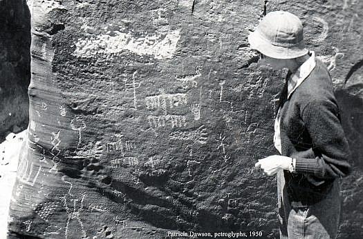 Patricia examining petroglyphs.